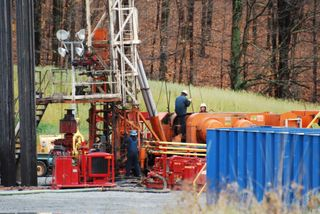 Drill rig workers, three