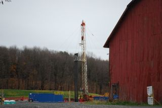 Drill rig, beside barn
