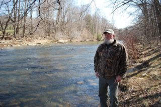 Ed Thompson beside Casselman River