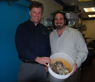 Brian Gomes (left) and Michael Stavlas (right) with oyster shells for recycling
