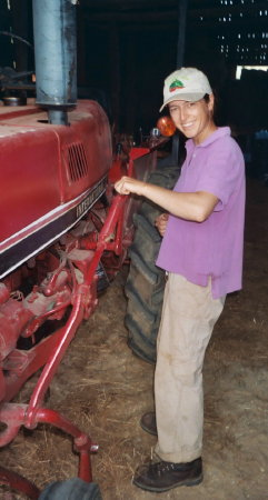 23. Carrie working on her favorite little red tractor